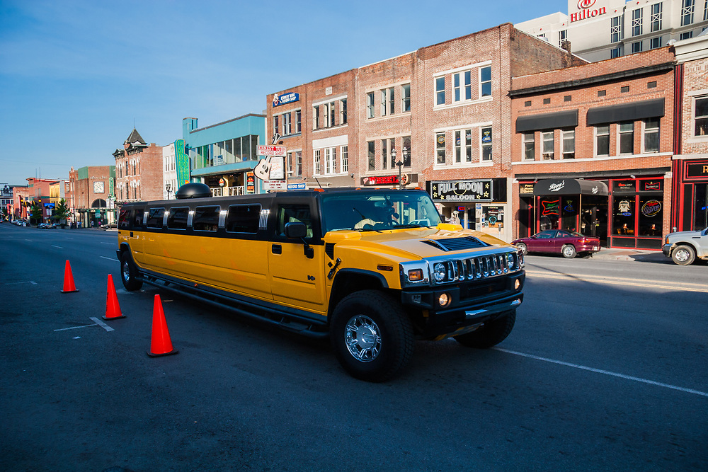Hummer limousine on Broadway in Nashville, Tennessee, USA. Limousine on your service, sir. Despite of it's fuel consumption the ride on the Hummer limo is something.