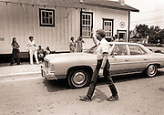 Shortly after announcing his bid for the presidency, Jimmy Carter walks past his Plains, Georgia, campaign headquarters without aides or security and—more often than not—going largely unrecognized.