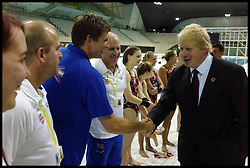 Britain's Prime Minister David Cameron and Mayor of London Boris Johnson (R) together with Jeremy Hunt Secretary of State for Culture, Olympics, Media and Sport Talk to British Diver Tom Daley and members of the British Diving team during a visit to the Olympic Aquatic Centre on January 9, 2012 in London, England. Cameron held a cabinet meeting at the 2012 Olympic Games site and highlighted the 'lasting legacy' the London 2012 Olympics will leave, as the London Olympics countdown enters its final 200 days, Monday January 9, 2012. Photo By Andrew Parsons/ i-Images