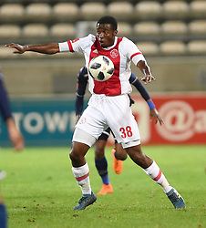 Cape Town-180411 Ajax Cape Town midfielder Gerald Takwara shields a ball when playing against  Wits defender Buhle Mkhwanazi in a PSL match played at Athlone stadium.photographer:Phando Jikelo/African News Agency/ANA
