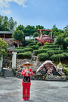 Guangxi, China - September 30, 2014 :Chinese woman in front of traditional tea house  between Guilin and Yangshuo in Guangxi province  China