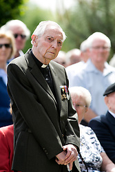 © Licensed to London News Pictures. 06/06/2014. National Memorial Arboretum, Alrews, Staffordshire, UK. The D Day service at the Normandy Memorial, National Memorial Arbouretum. Pictured, Normandy Veteran Rev Dick Sargent (90), who salied on the Empire Gauntlett and landed on the beaches on D Day taking part in the sevice at the N.M.A. Photo credit : Dave Warren/LNP