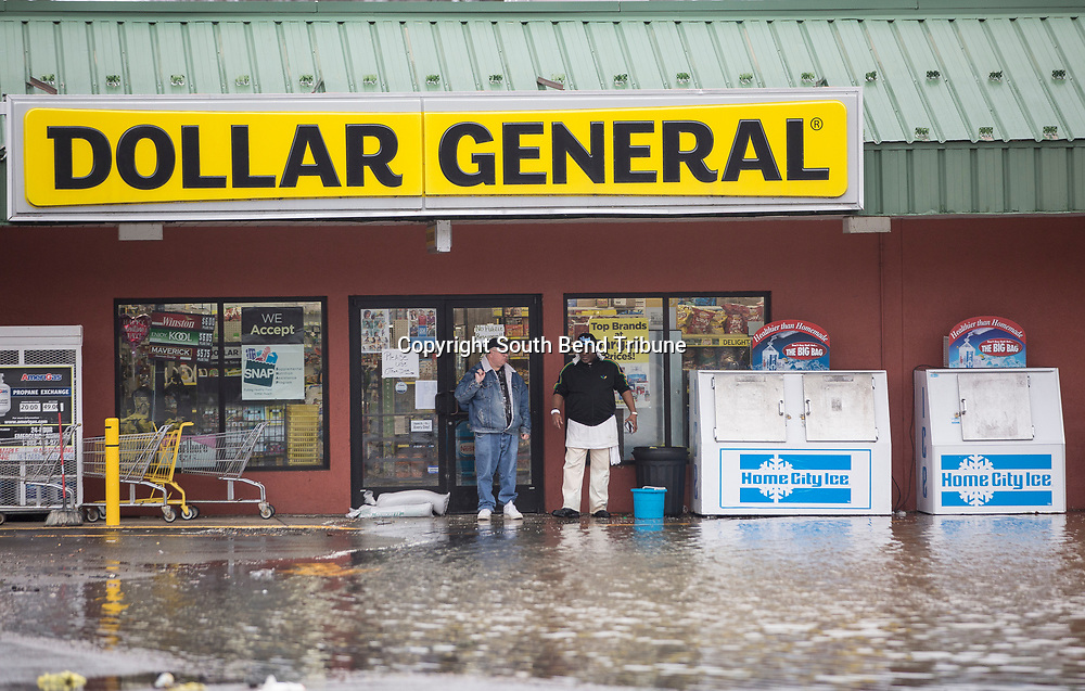 A couple of men talk in front of the Dollar store on  Wednesday, Feb. 21, 2018, in Niles. Tribune Photo/SANTIAGO FLORES