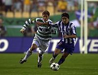 Photo: Greig Cowie<br /> Celtic v Porto. UEFA Cup Final. Seville. 21/05/2003<br /> Deca takes on Stilian Petrov
