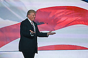 GOP Presidential nominee Donald Trump walks out on stage to congratulate his running mate Gov. Mike Pence after Pence formally accepted the nomination during the third day of the Republican National Convention July 20, 2016 in Cleveland, Ohio.