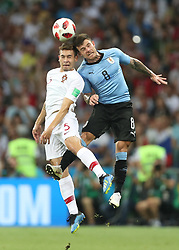 SOCHI, June 30, 2018  Raphael Guerreiro (L) of Portugal competes for a header with Nahitan Nandez of Uruguay during the 2018 FIFA World Cup round of 16 match between Uruguay and Portugal in Sochi, Russia, June 30, 2018. (Credit Image: © Fei Maohua/Xinhua via ZUMA Wire)