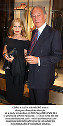 LORD & LADY WEINBERG she is designer Anoushka Hemple, at a party in London on 18th May 2004.PUG 384