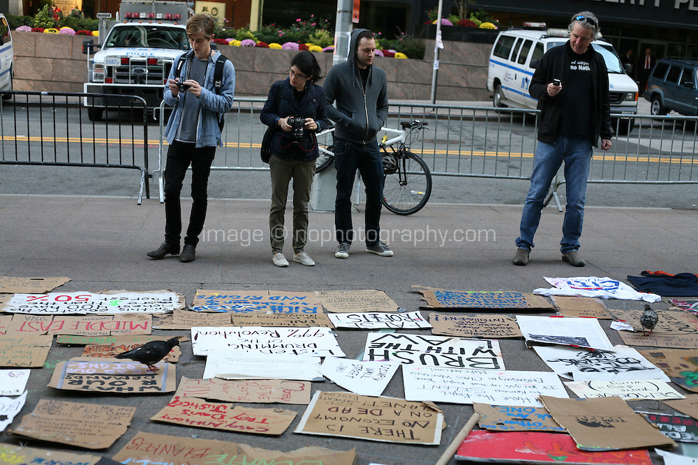 Placards at the Occupy Wall Street protest at Zuccotti Park in the financial district New York