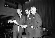 """24/07/1967<br /> 07/24/1967<br /> 24 July 1967<br /> First showing of """"Fleá Cheoil"""" at the Metropole Cinema, Dublin. A presentation was made to the director of the film Mr. Louis Marcus, for winning the Silver Bear Award at the Berlin International Film Festival, by Taoiseach Jack Lynch TD, on behalf of the Cork Film Society, where Mr. Marcus began his carrier. President of the Society Mr. Sean Hendrick attended the presentation. Image shows (l-r): Taoiseach Jack Lynch; Louis Marcus and Sean Hendrick examining the scroll that was presented to Mr. Marcus."""