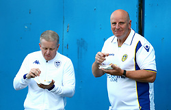 Leeds United fans enjoy a bite to eat outside Elland Road prior to the match
