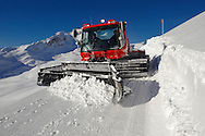 Piste machine in the winter Snow in the mountains near Grindelwald First - Swiss Alps - Switzerland