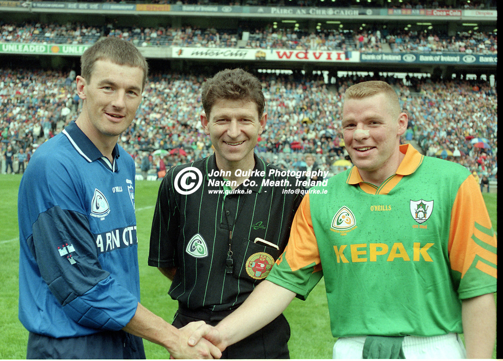 28-07-1996. Meath v Dublin - Leinster SFC Final at Croke Park.<br />Dublin Captain John O'Leary and Meath Captain  Tommy Dowd shaking hands. Brian White, Wexford is the referee.<br />Photo: John Quirke / www.quirke.ie<br />©John Quirke Photography, 16 Proudstown Road, Navan. Co. Meath. (info@quirke.ie / 046-9028461 / 087-2579454).