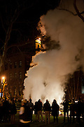 Clouds of steam rise into the night sky, marking a festive beginning to the new year.