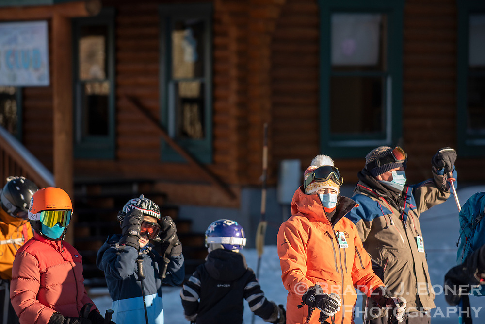 Skiers wait in line for the Dreamcatcher Lift to start spinning for the opening day at Grand Targhee Resort on Friday.