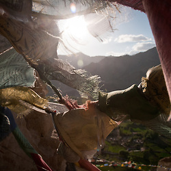 Prayer flags can be seen stretched between peaks of mountains and hanging on the ruins of ancient mountain top structures.