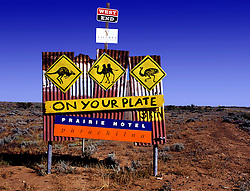 Road sign advertising Prairie Hotel that cooks many types of wild animals at Parachilna in outback Australia