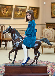 Clementine (4) from Edinburgh with a bronze of the Arabian Stallion Twaig, expected to fetch in excess of £10,000 when it goes under the hammer at Bonhams sporting auction in Edinburgh this week.<br /> <br /> © Dave Johnston/ EEm