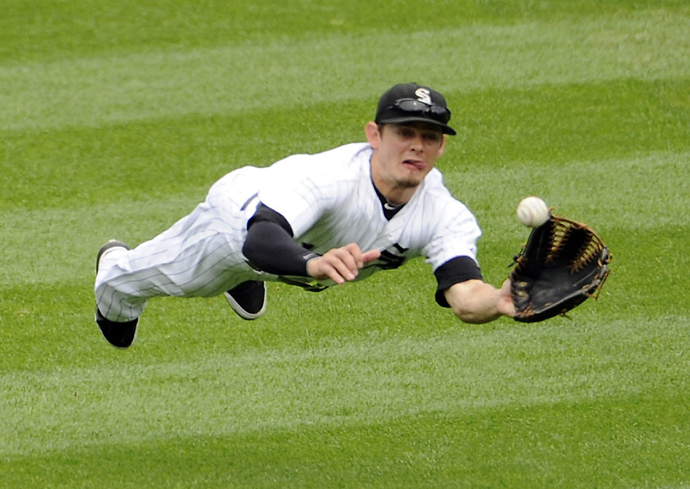 CHICAGO - JUNE 25:  Brent Lillibridge #18 of the Chicago White Sox makes a diving catch of a ball hit by Ivan Rodriguez #7 of the Washington Nationals in the second inning on June 25, 2011 at U.S. Cellular Field in Chicago, Illinois.  (Photo by Ron Vesely)   Subject:  Brent Lillibridge;Ivan Rodriguez
