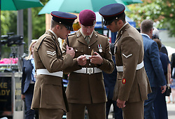 Members of the Armed Forces check their betting slips during day four of Royal Ascot at Ascot Racecourse.