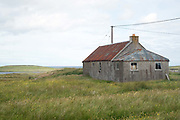 An abandoned house in the village of  Shawbost on the Isle of Lewis, Outer Hebrides, Scotland on 19 July 2018