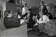 "January 1977 – Plains, Georgia)  President-elect Jimmy Carter talks with several his closest advisors and transition team members at the Carter's family retreat ""Pond House"" just outside of the small south Georgia town of Plains. . Left to right are:  Michael Blumenthal, (Treasury Secretary nominee),  Stuart Eizenstat, (Chief Domestic Policy Advisor), Jack Watson, (Transition Director and later Chief of Staff),  Unidentified (dark hair, glasses, standing), Charles Schultze, (Chairman of the Council of Economic Advisors)."
