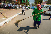 """04 FEBRUARY 2013 - PHNOM PENH, CAMBODIA: A street sweeper cleans the street in front of the National Museum before the cremation of King-Father Norodom Sihanouk in Phnom Penh. Norodom Sihanouk (31 October 1922- 15 October 2012) was the King of Cambodia from 1941 to 1955 and again from 1993 to 2004. He was the effective ruler of Cambodia from 1953 to 1970. After his second abdication in 2004, he was given the honorific of """"The King-Father of Cambodia."""" Sihanouk died in Beijing, China, where he was receiving medical care, on Oct. 15, 2012.    PHOTO BY JACK KURTZ"""