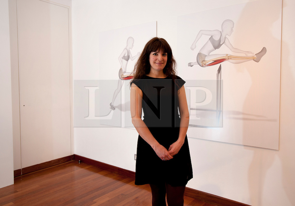 """© Licensed to London News Pictures. 12/03/2012. London, UK. Emily Evans exhibits her """"Hurdles"""" exhibition, which illustrates the process of a tearing ham string during a hurdle.. Photo credit : Spike Johnson/LNP"""