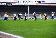 A group of Coventry City players arrive at the ground and walk on the pitch as the empty Britcon Stand at Glanford Park is behind them before the EFL Sky Bet League 1 match between Scunthorpe United and Coventry City at Glanford Park, Scunthorpe, England on 5 January 2019.