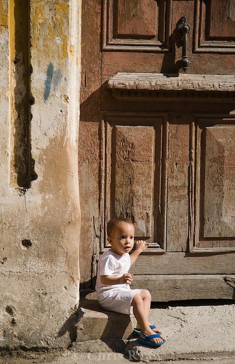 Boy on doorstep, Havana Vieja, Cuba
