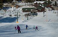 "The Pasay family Emerson, Erin, Justin, Blake and Burke ski down Phelps Trail taking their first ""blue"" trail run at Gunstock Friday afternoon.  ©2021 Karen Bobotas Photographer"