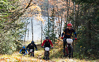 Cyclists grind up Rock Loop trail during the Fall Flurry mountain bike race at Gunstock.  (Karen Bobotas Photographer)