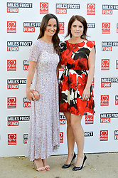 Left to right, PIPPA MIDDLETON and PRINCESS EUGENIE OF YORK at the Frost Family Summer party in support of the British Heart Foundation and the Mile Frost Fund held at Burton Court, Chelsea, London  on 18th July 2016.