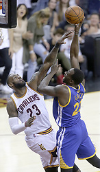 June 9, 2017 - Cleveland, OH, USA - The Cleveland Cavaliers' LeBron James, left, defends a shot inside by the Golden State Warriors' Draymond Green during Game 4 of the NBA Finals at Quicken Loans Arena in Cleveland on Friday, June 9, 2017. The Cavs won, 137-116, trimming their series deficit to 3-1. (Credit Image: © Phil Masturzo/TNS via ZUMA Wire)