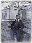 adult man sitting outside the houseboat Paris 1900s