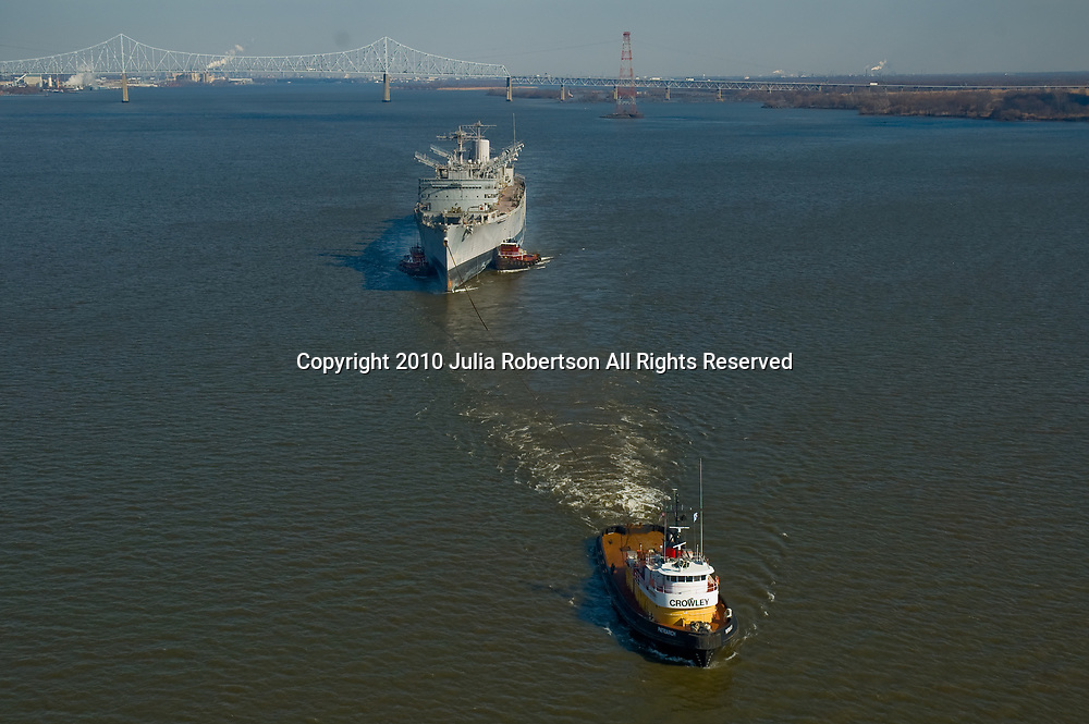 Aerial view of the Crowley's Patriarch tugboat pulling the USS Seattle south down the Delaware River