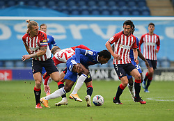 Jevani Brown of Colchester United is tackled by Alfie McCalmont of Oldham Athletic - Mandatory by-line: Arron Gent/JMP - 03/10/2020 - FOOTBALL - JobServe Community Stadium - Colchester, England - Colchester United v Oldham Athletic - Sky Bet League Two