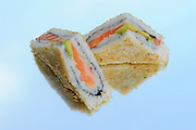 Sushi sandwich on reflective background