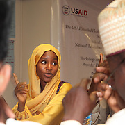 INDIVIDUAL(S) PHOTOGRAPHED: Zainab Abdurrahman. LOCATION: Financing Workshop, Lagos, Nigeria. CAPTION: During small group discussions towards the end of the workshop, participants shared their ideas on how to improve financing approaches in Nigeria's health care sector.