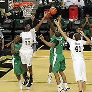 Central Florida forward Keith Clanton (33), Marshall forward Johnny Thomas (0) and Central Florida center Tom Herzog (41) jump for a rebound during a Conference USA NCAA basketball game between the Marshall Thundering Herd and the Central Florida Knights at the UCF Arena on January 5, 2011 in Orlando, Florida. Central Florida won the game 65-58 and extended their record to 14-0.  (AP Photo/Alex Menendez)