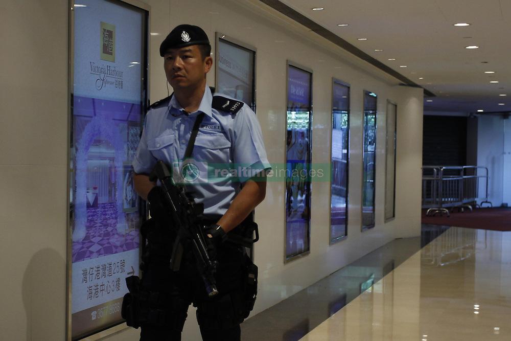 June 29, 2017 - Hong Kong, CHINA - Policeman equipped with automatic assault rifle patrol inside the shopping arcade as Hong Kong prepare for Chinese President Xi Jin Pings 3 days official visit. June 29, 2017.Hong Kong.ZUMA/Liau Chung Ren (Credit Image: © Liau Chung Ren via ZUMA Wire)