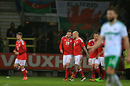 Simon Church of Wales (19) celebrates with teammates after he score his teams 1st goal from a penalty to equalise at 1-1. Wales v Northern Ireland, International football friendly match at the Cardiff City Stadium in Cardiff, South Wales on Thursday 24th March 2016. The teams are preparing for this summer's Euro 2016 tournament.     pic by  Andrew Orchard, Andrew Orchard sports photography.