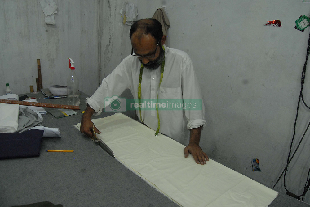June 10, 2017 - Pakistan - Tailors busy in stitching clothes at their workplace. (Credit Image: © Zubair Abbasi/Pacific Press via ZUMA Wire)