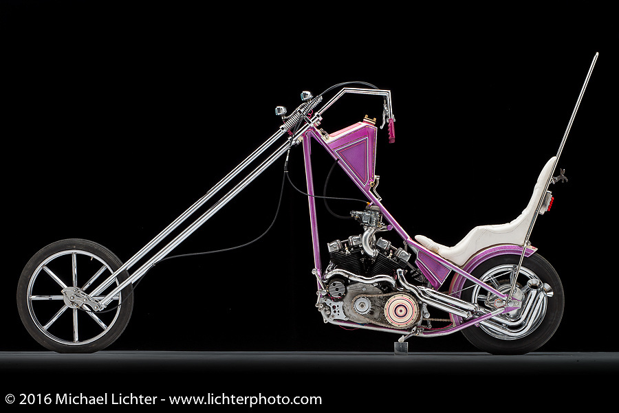 """""""The Glam Fairy"""", a pink and purple 1965 Ironhead Sportster chopper built by Eric Allard of FNA Custom Cycles in Lakeland, FL. Photographed by Michael Lichter in Sturgis, SD on August 5, 2016. ©2016 Michael Lichter."""