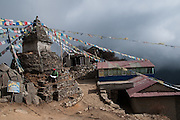 Nepal, Khumbu, Everest region, Annie Miniscloux beside a Chorten/Stupa, village of Mong.