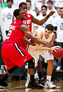 SHOT 1/28/12 3:39:11 PM - Colorado State's Dorian Green #22 is surrounded by San Diego State's Xavier Thames #2 and Chase Tapley #22 during their regular season Mountain West conference game at Moby Arena in Fort Collins, Co. Colorado State upset 12th ranked San Diego State 77-60. (Photo by Marc Piscotty / © 2012)