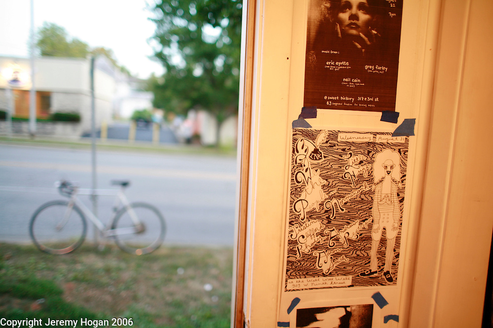 A bicycle sits out side the door on the sidewalk at Sweet Hickory art gallery on Third Street in Bloomington, Indiana. Sweet Hickory is the location of many art opening and underground music performances and was started by two members of the punk band Defiance Ohio.