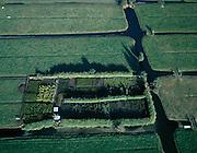Nederland, Zuid-Holland, Alblasserwaard, 17-10-2003; luchtfoto (25% toeslag); polder Ottoland (tussen Gorinchem en Schoonhoven); tussen de weilanden een kleine kwekerij van planten, heesters, bomen - door coniferen omzoomd (windsingel); weiland, gras, landbouw, tuinbouw, verkaveling, landschap  ..Foto Siebe Swart