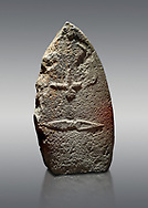 Late European Neolithic prehistoric Menhir standing stone with carvings on its face side. The representation of a stylalised male figure starts at the top with a long nose from which 2 eyebrows arch around the top of the stone. below this is a carving of a falling figure with head at the bottom and 2 curved arms encircling a body above. at the bottom is a carving of a dagger running horizontally across the menhir. the bottom is a carving of a dagger running horizontally across the menhir. Excavated from Piscina 'E Sali VI site,  Laconi.  Menhir Museum, Museo della Statuaria Prehistorica in Sardegna, Museum of Prehoistoric Sardinian Statues, Palazzo Aymerich, Laconi, Sardinia, Italy. Grey background. .<br /> <br /> Visit our PREHISTORIC PLACES PHOTO COLLECTIONS for more photos to download or buy as prints https://funkystock.photoshelter.com/gallery-collection/Prehistoric-Neolithic-Sites-Art-Artefacts-Pictures-Photos/C0000tfxw63zrUT4
