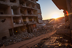 A overview of a destructed building where 5 floors have been collapsed  by an airplane bombing in the empty city of Maarat al-Numan. February 12, 2013...the bombing begun October 8th, 2012. A city of couple hundreds thousends is almost emply with residents living in no more than 1500, Syria, February 12, 2013. Photo by Daniel Leal-Olivas / i-Images...