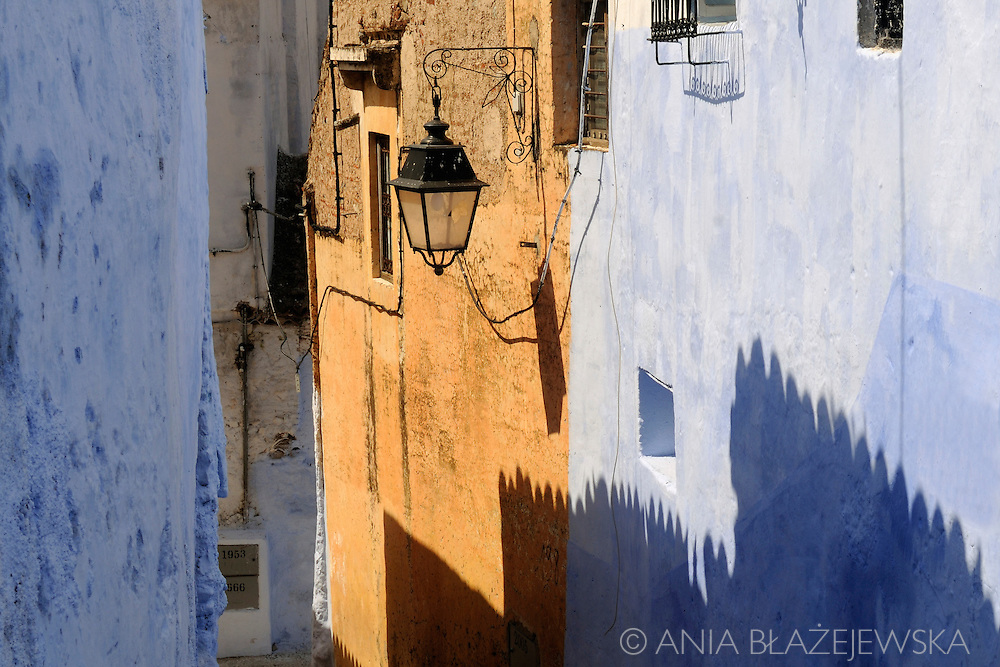 Morocco, Chefchaouen. Shadows in the colorful street.